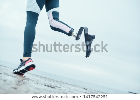 Cropped photo of strong handicapped woman with prosthesis in tra Stock photo © deandrobot