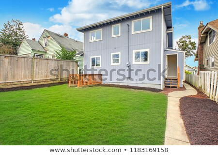 Large fully fenced back yard with well kept lawn. Stock photo © iriana88w