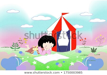 girls reading book in park with rainbow in sky stock photo © colematt