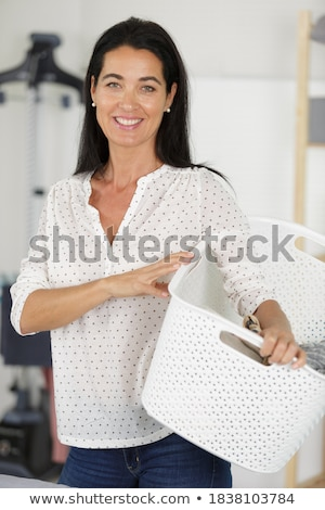 Happy homemaker wife carrying basket with the laundry  Stock photo © Kzenon