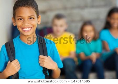 Derűs afroamerikai általános iskola fiú hátizsák iskola Stock fotó © Lopolo