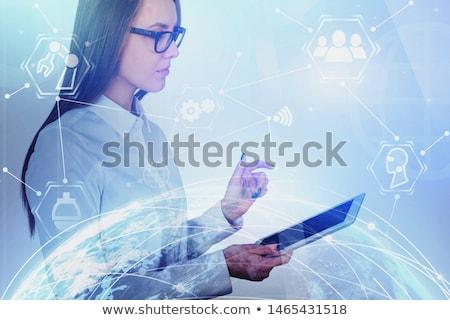woman touching hologram stock photo © ra2studio