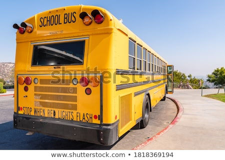 school bus in old city riding transport for kids stock photo © robuart