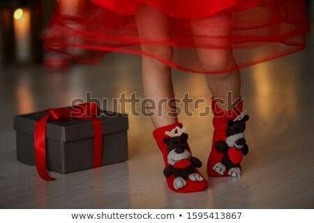Crianças pernas vermelho natal meias madeira Foto stock © ElenaBatkova