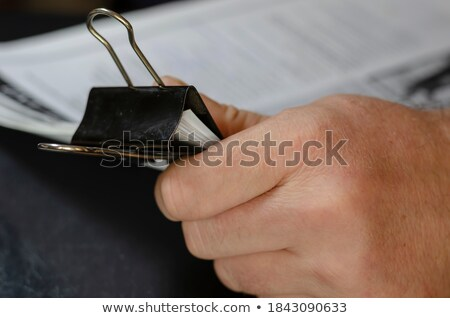 Black paperclip holding sheets of paper  Stock photo © inxti