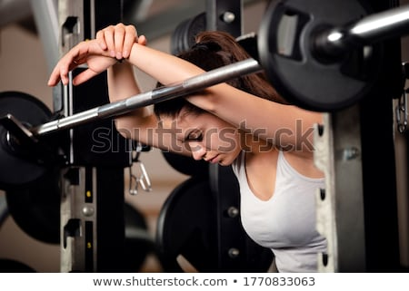 Pretty brunette lifting barbell Stock photo © photography33