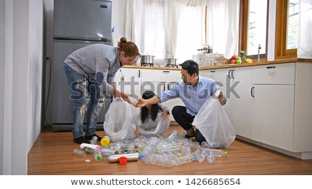 Young woman and boyfriend recycling plastic Stock photo © photography33