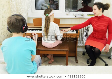 Three teenage musicians sitting in bed room Stock photo © photography33