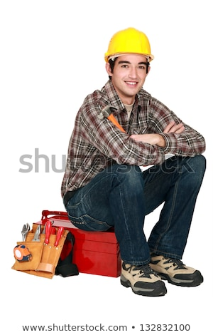 portrait of young craftsman sitting on toolcase Stock photo © photography33