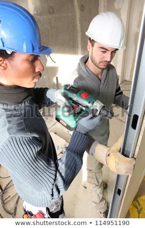 Gipsplaten muur home mannen werken Stockfoto © photography33
