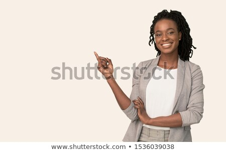 African female secretary pointing at copy space Stock photo © stockyimages