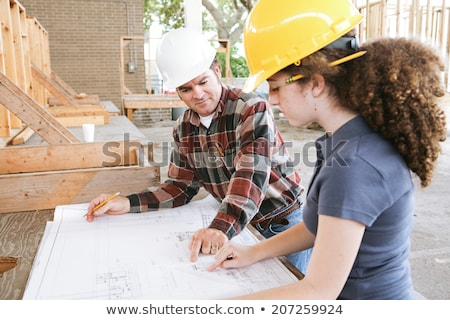 engineering student reads blueprints stock photo © lisafx