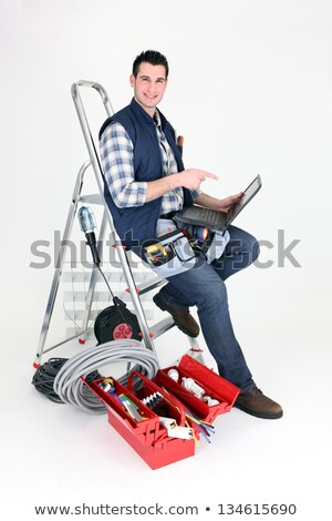 Electrician perched on step ladder Stock photo © photography33