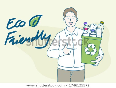 young man holding a recycling bin stock photo © photography33