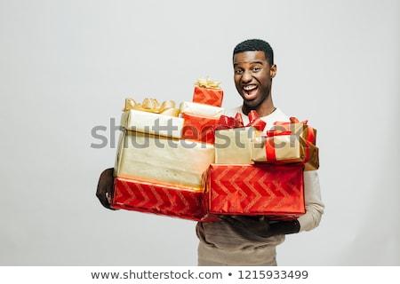 Férfi hordoz ajándékok fickó szép ajándékok Stock fotó © photography33