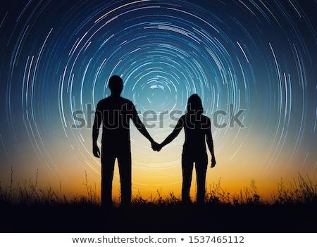 couple in love under the stars stock photo © kotenko