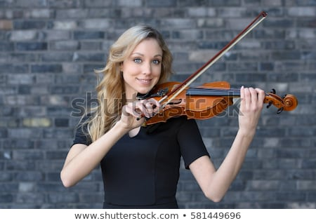 young smiling girl with her violin stock photo © melpomene