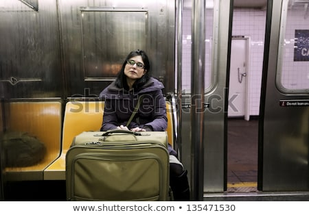 Stock photo: Woman with Suitcase in New-York Subway