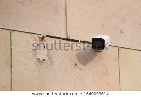 Biztonsági kamera modern fal épület utca város Stock fotó © kyolshin