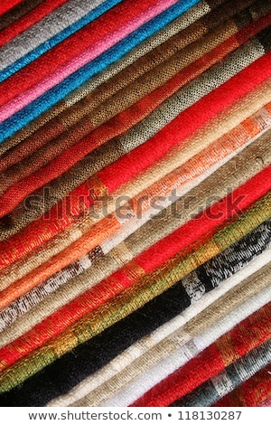 stacked table linens in otavalo stock photo © rhamm