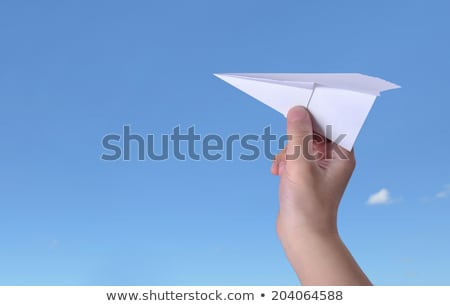 Papieren vliegtuig kinderen hand blauwe hemel zonnige zomer Stockfoto © lunamarina