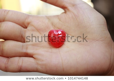 Heart shape candy on woman macro mouth stock photo © lunamarina