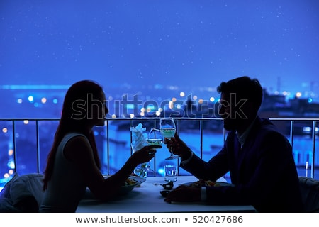 Young happy couple having romantic date at restaurant Stock photo © HASLOO