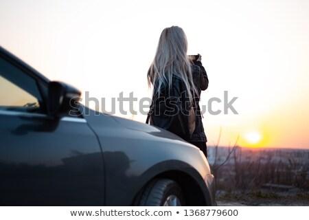 blonde woman near black automobile Stock photo © ssuaphoto