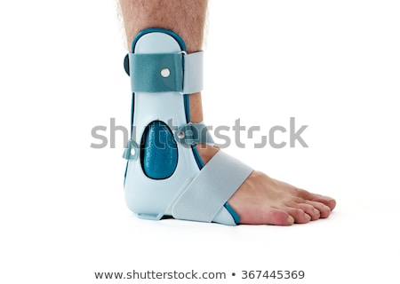 Close-up Of Man Wearing Brace On Foot Stock photo © AndreyPopov