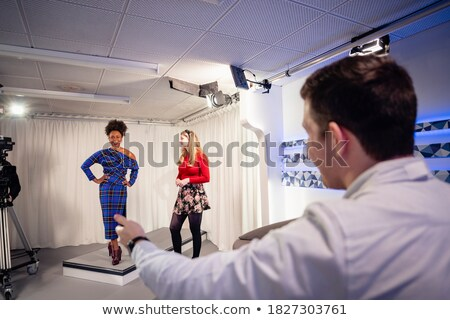Woman standing with hand on hip behind curtain Stock photo © AndreyPopov