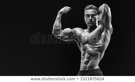 Stock photo: Body builder posing