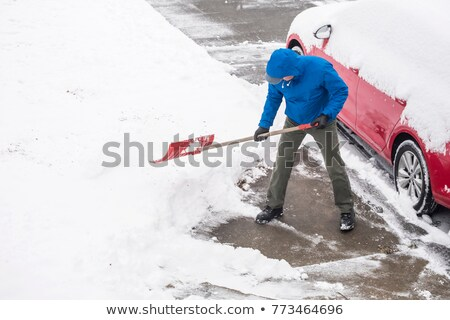 Young man clearing snow Stock photo © monkey_business