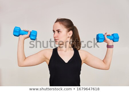 Beautiful slim woman with dumbbells on white background stock photo © vlad_star