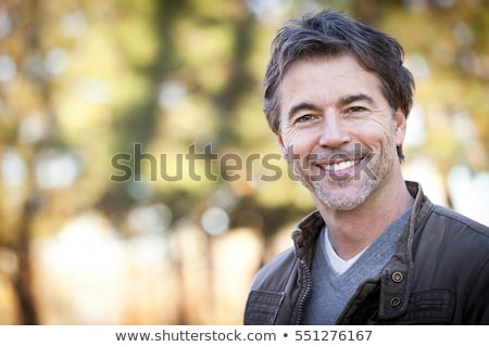 Mosolyog férfi kabát jóképű barna arc Stock fotó © feelphotoart