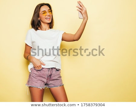 Sexy fashion girl in jeans Stock photo © phakimata