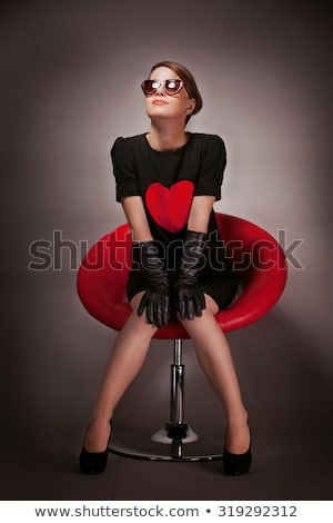 sexy woman sitting on chair stock photo © dash