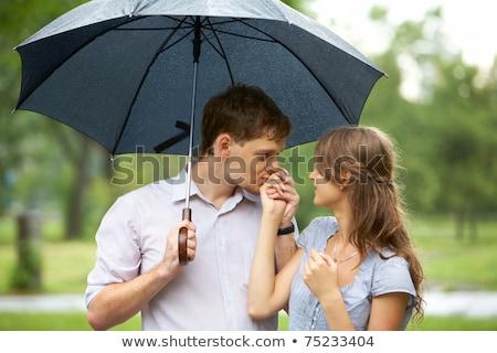 Fidanzato bacio ragazza mano natura amore Foto d'archivio © fuzzbones0
