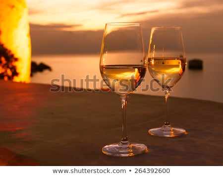 table with two glasses of wine on sunset on sea outdoor stock photo © paha_l