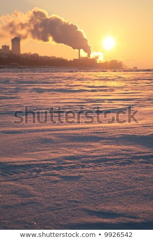 smoke from the pipes above the frozen river 2 Stock photo © Paha_L