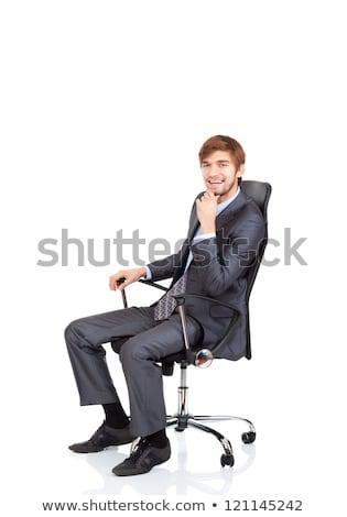 Empresário sessão cadeira de escritório mão queixo branco Foto stock © wavebreak_media