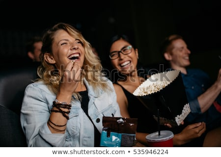 Stok fotoğraf: Happy Friends Watching Movie In Theater
