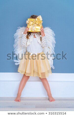 Little angel girl holding a present Stock photo © lovleah