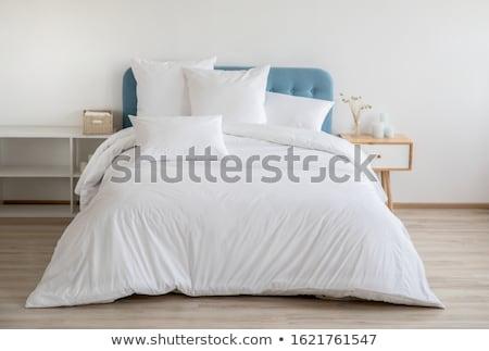 White bedding sheet and pillow Stock photo © nalinratphi