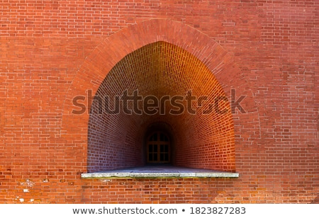 Fragment of a red brick wall with an arch. Stock photo © zeffss