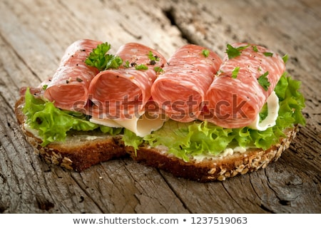 Pan de trigo entero salchicha rebanadas madera carne Foto stock © Digifoodstock