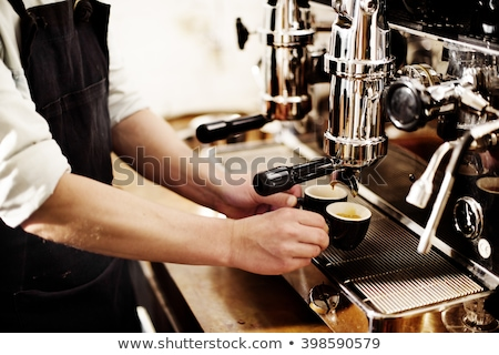Foto stock: Waitress Preparing Espresso At Restaurant