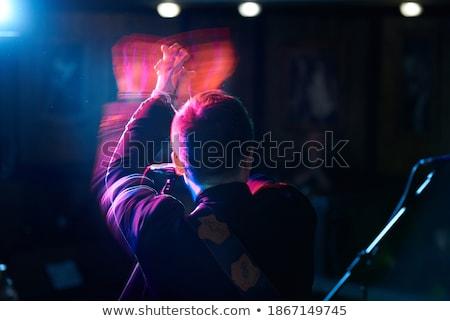 Male singer performing with guitar in night club Stock photo © wavebreak_media