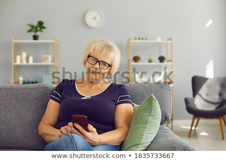 Blonde woman sitting on bank safe Stock photo © studioworkstock
