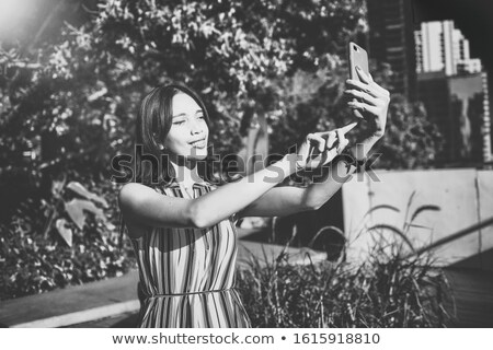 Young woman teking selfie on the street stock photo © boggy