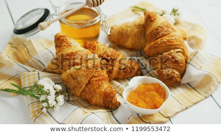 Condiments and croissants lying on towel Stock photo © dash
